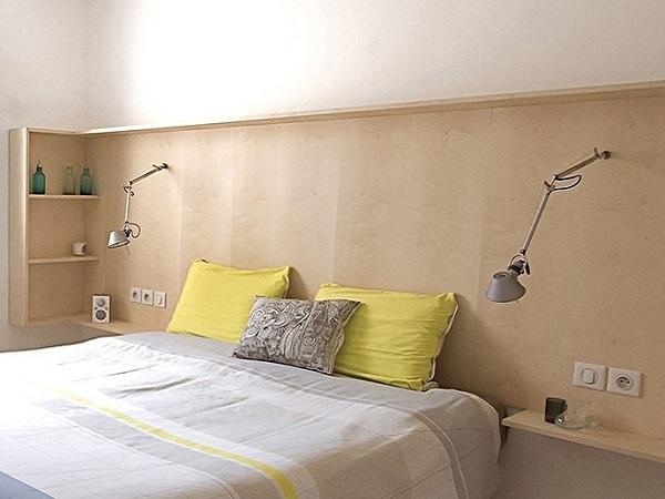 Bedroom with Headboard Shelving Green Bedspread