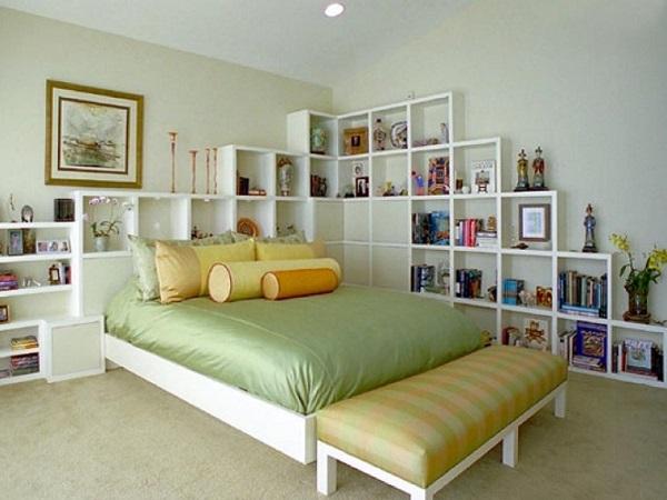 Bedroom with hidden storage headboard book shelf above bed