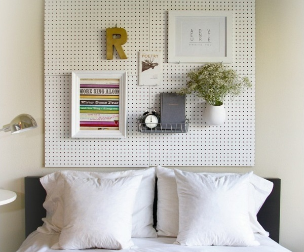 Bedroom with pegboard headboard with white pillows and Eclectic Accents